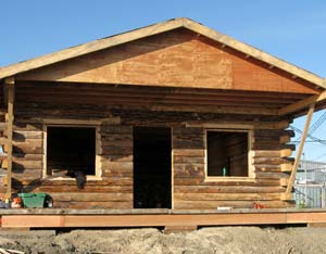 log house built with yukon river logs